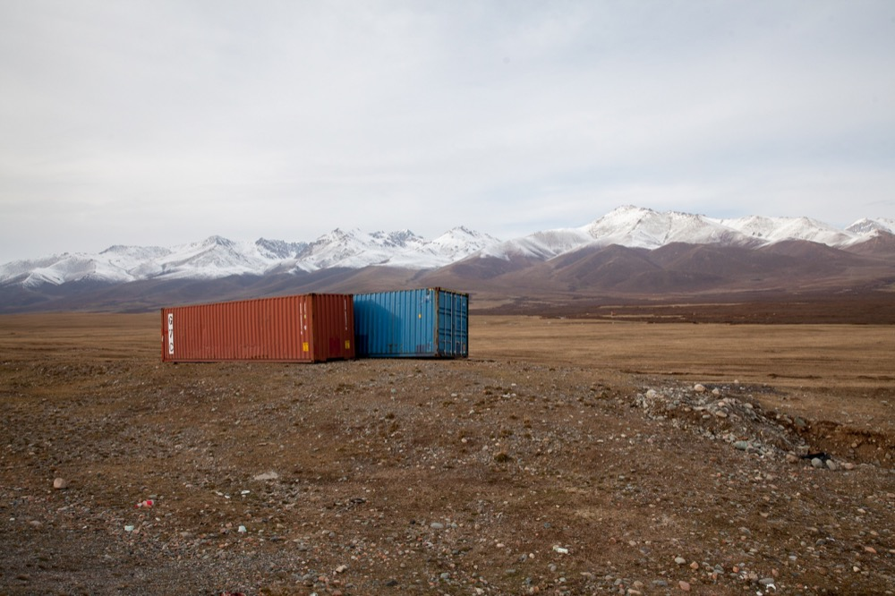 Empty shipping containers in the highlands of Kyrgyzstan. © 2014 Martin Saxer